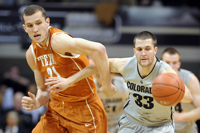 Matt Hill, left, of Texas, and Austin Dufault of CU chase down a loose ball. For more photos of the game, go to www.dailycamera.com Cliff Grassmick / February 26, 2011