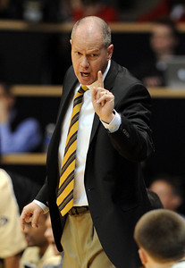 Tad  Boyle, CU coach, instructs Levi Knutson against Texas. For more photos of the game, go to www.dailycamera.com Cliff Grassmick / February 26, 2011