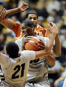 Alec Burks of CU, gets a rebound in front of Tristan Thompson of Texas. For more photos of the game, go to www.dailycamera.com Cliff Grassmick / February 26, 2011