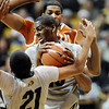"Alec Burks of CU, gets a rebound in front of Tristan Thompson of Texas.<br /> For more photos of the game, go to  <a href=""http://www.dailycamera.com"">http://www.dailycamera.com</a><br /> Cliff Grassmick / February 26, 2011"