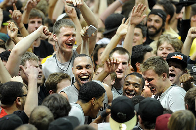 Ben Mills, left, Marcus Relphorde, Levi Knutson, Shannon Sharpe and Trey Eckloff, join fans an players celebrating the upset win over #5 Texas on Saturday. For more photos of the game, go to www.dailycamera.com Cliff Grassmick / February 26, 2011