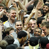 "Ben Mills, left, Marcus Relphorde, Levi Knutson, Shannon Sharpe and Trey Eckloff, join fans an players celebrating the upset win over #5 Texas on Saturday.<br /> For more photos of the game, go to  <a href=""http://www.dailycamera.com"">http://www.dailycamera.com</a><br /> Cliff Grassmick / February 26, 2011"
