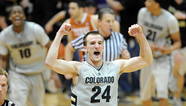 Levi Knutson of Colorado, celebrates the upset win over #5 Texas on Saturday. For more photos of the game, go to www.dailycamera.com Cliff Grassmick / February 26, 2011