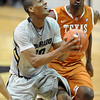 "Alec Burks of CU drives past Jordan Hamilton of Texas.<br /> For more photos of the game, go to  <a href=""http://www.dailycamera.com"">http://www.dailycamera.com</a><br /> Cliff Grassmick / February 26, 2011"