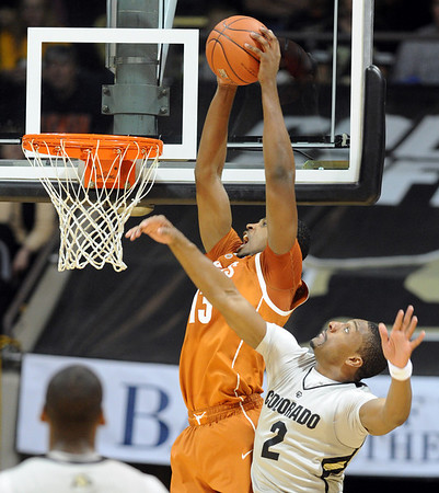 """Tristan Thompson of Texas, dunks over Shannon Sharpe of CU.<br /> For more photos of the game, go to  <a href=""""http://www.dailycamera.com"""">http://www.dailycamera.com</a><br /> Cliff Grassmick / February 26, 2011"""