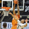 "Tristan Thompson of Texas, dunks over Shannon Sharpe of CU.<br /> For more photos of the game, go to  <a href=""http://www.dailycamera.com"">http://www.dailycamera.com</a><br /> Cliff Grassmick / February 26, 2011"