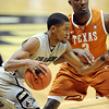 "Cory Higgins of CU drives past Jordan Hamilton of Texas.<br /> For more photos of the game, go to  <a href=""http://www.dailycamera.com"">http://www.dailycamera.com</a><br /> Cliff Grassmick / February 26, 2011"