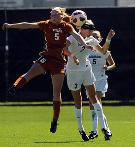 Hannah Higgins, left, of Texas, and  Alex Drohm of CU, go up on a header in Sunday's game. For more photos of the game, go to www.dailycamera.com. Cliff Grassmick / September 26, 2010