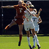 "Hannah Higgins, left, of Texas, and  Alex Drohm of CU, go up on a header in Sunday's game.<br /> For more photos of the game, go to  <a href=""http://www.dailycamera.com"">http://www.dailycamera.com</a>.<br /> Cliff Grassmick / September 26, 2010"