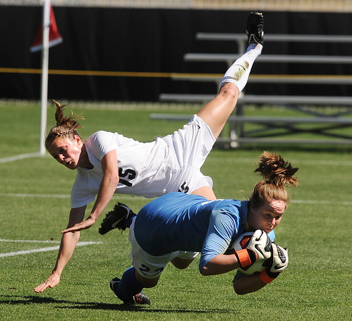"""Hayley Hughes of Colorado, collides with Texas keeper, Alexa Gaul, on Sunday.<br /> For more photos of the game, go to  <a href=""""http://www.dailycamera.com"""">http://www.dailycamera.com</a>.<br /> Cliff Grassmick / September 26, 2010"""
