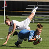 "Hayley Hughes of Colorado, collides with Texas keeper, Alexa Gaul, on Sunday.<br /> For more photos of the game, go to  <a href=""http://www.dailycamera.com"">http://www.dailycamera.com</a>.<br /> Cliff Grassmick / September 26, 2010"