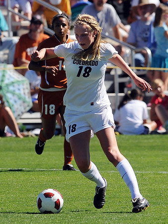 "Lizzy Herzl of Colorado works against Texas on Sunday.<br /> For more photos of the game, go to  <a href=""http://www.dailycamera.com"">http://www.dailycamera.com</a>.<br /> Cliff Grassmick / September 26, 2010"