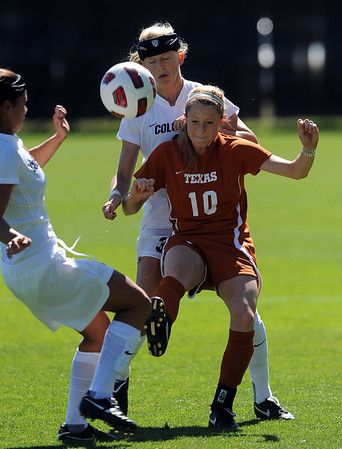 "Kym Lowry, left, of CU, and Alex Dohm, pressures Leah Fortune (10) of Texas.<br /> For more photos of the game, go to  <a href=""http://www.dailycamera.com"">http://www.dailycamera.com</a>.<br /> Cliff Grassmick / September 26, 2010"