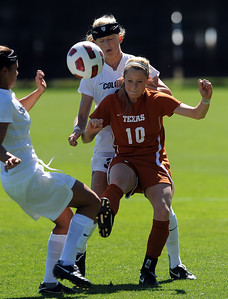 Kym Lowry, left, of CU, and Alex Dohm, pressures Leah Fortune (10) of Texas. For more photos of the game, go to www.dailycamera.com. Cliff Grassmick / September 26, 2010