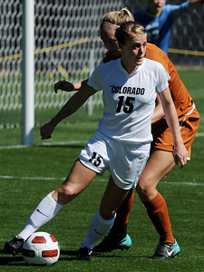 Hayley Hughes of Colorado, works against Texas on Sunday. For more photos of the game, go to www.dailycamera.com. Cliff Grassmick / September 26, 2010