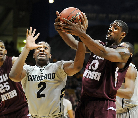 "Shannon Sharpe, left, of Colorado and Kevin Galloway of Texas Southern, struggle for a rebound during the first half of the March 16, 2011 NIT game in Boulder, Colo.<br /> For more photos of the game, go to  <a href=""http://www.dailycamera.com"">http://www.dailycamera.com</a>.<br /> Cliff Grassmick / March 16, 2011"