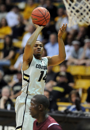 """Javon Coney of CU scores against Texas Southern<br /> during the second half of the March 16, 2011 NIT game in Boulder, Colo.<br /> For more photos of the game, go to  <a href=""""http://www.dailycamera.com"""">http://www.dailycamera.com</a>.<br /> Cliff Grassmick / March 16, 2011"""