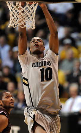 "Alec Burks of CU scores against Texas Southern during the second half of the March 16, 2011 NIT game in Boulder, Colo.<br /> For more photos of the game, go to  <a href=""http://www.dailycamera.com"">http://www.dailycamera.com</a>.<br /> Cliff Grassmick / March 16, 2011"