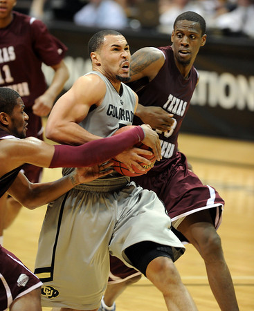 """Marcus Relphorde of Colorado drives between Harrison Smith, left, and Kevin Galloway, both of Texas Southern<br /> during the second half of the March 16, 2011 NIT game in Boulder, Colo.<br /> For more photos of the game, go to  <a href=""""http://www.dailycamera.com"""">http://www.dailycamera.com</a>.<br /> Cliff Grassmick / March 16, 2011"""