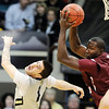 """Daniel King of Texas Southern, gets a rebound over Nate Tomlinson of Colorado, during the first half of the March 16, 2011 NIT game in Boulder, Colo.<br /> For more photos of the game, go to  <a href=""""http://www.dailycamera.com"""">http://www.dailycamera.com</a>.<br /> Cliff Grassmick / March 16, 2011"""