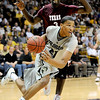 """Andre Roberson of Colorado dribbles around Daniel King of Texas Southern <br /> during the first half of the March 16, 2011 NIT game in Boulder, Colo.<br /> For more photos of the game, go to  <a href=""""http://www.dailycamera.com"""">http://www.dailycamera.com</a>.<br /> Cliff Grassmick / March 16, 2011"""