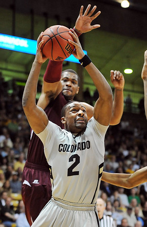"""Shannon Sharpe of CU shoots under Harrison Smith of Texas Southern<br /> during the first half of the March 16, 2011 NIT game in Boulder, Colo.<br /> For more photos of the game, go to  <a href=""""http://www.dailycamera.com"""">http://www.dailycamera.com</a>.<br /> Cliff Grassmick / March 16, 2011"""