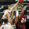 """Andre Roberson, left, of Colorado, blocks the shot of Travele Jones of Texas Southern, during the first half of the March 16, 2011 NIT game in Boulder, Colo.<br /> For more photos of the game, go to  <a href=""""http://www.dailycamera.com"""">http://www.dailycamera.com</a>.<br /> Cliff Grassmick / March 16, 2011"""