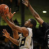 Cory Higgins, left, of Colorado, drives to the basket past Travele Jones of Texas Southern during the first half of the November 18, 2009 game in Boulder.<br /> <br /> Cliff Grassmick /November 18, 2009