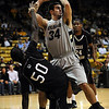 Casey Crawford (34) of Colorado gets a rebound over Onyekautukwu Abiakam (50) of Texas Southern during the first half of the November 18, 2009 game in Boulder.<br /> <br /> Cliff Grassmick /November 18, 2009