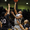 Cory Higgins of CU, puts up a shot over Jason West of Texas Southern on Wednesday.<br /> <br /> Cliff Grassmick /November 18, 2009
