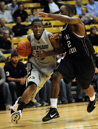 Alec Burks of CU, drives on Marc Ellis of Texas Southern on Wednesday.<br /> <br /> Cliff Grassmick /November 18, 2009