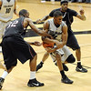 Cory Higgins of CU tries to pull away from Aaron Clayborn of Texas Southern.<br /> Cliff Grassmick / November 18, 2009