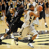 Alec Burks takes off on the fast break against Texas Southern.<br /> Cliff Grassmick / November 18, 2009