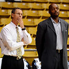 Colorado Basketball coach, Jeff Bzdelik, left, talks with Texas Southern assistant and former Nugget, Nick Van Exel.<br /> <br /> Cliff Grassmick /November 18, 2009