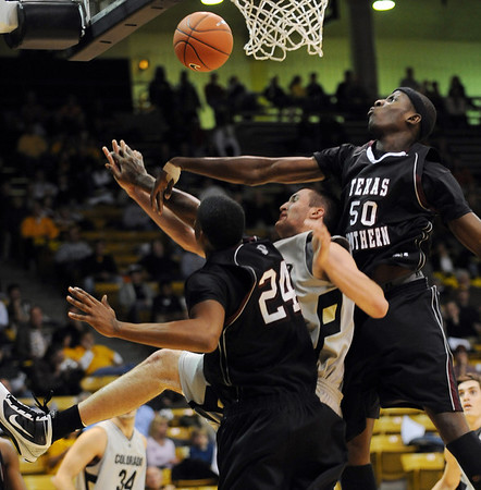 Austin Default of Colorado gets caught between Travele Jones (24) of Texas Southern, and Onyekautukwu Abiakam of Texas Southern.<br /> <br /> Cliff Grassmick /November 18, 2009