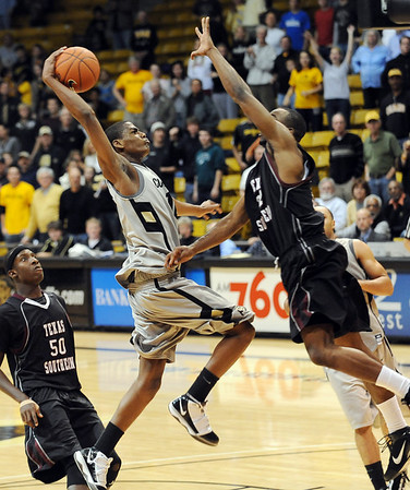 Alec Burks goes strong to the hole against Texas Southern.<br /> Cliff Grassmick / November 18, 2009