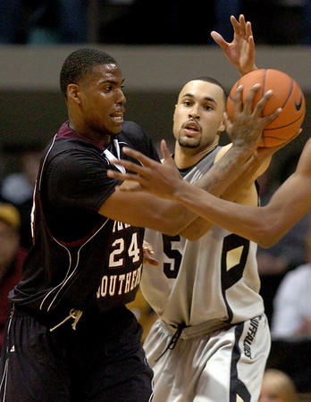 Travele Jones, left, of Texas Southern, tries to get around the defense of Marcus Relphorde (5) of Colorado during the first half of the November 18, 2009 game in Boulder.<br /> <br /> Cliff Grassmick /November 18, 2009
