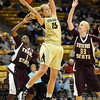 "Julie Seabrook of CU grabs a rebound between Verinus Kalu, left, and Ashley Shoemaker, of Texas State.<br /> For more photos of the game, go to  <a href=""http://www.dailycamera.com"">http://www.dailycamera.com</a>.<br /> Cliff Grassmick / December 1, 2010"