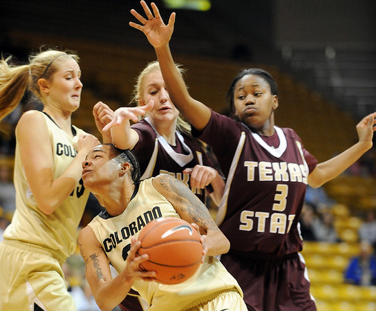 """Chucky Jeffery of Colorado, puts up a shot under Ashley Shoemaker, left, and Diamond Ford of Texas State.<br /> For more photos of the game, go to  <a href=""""http://www.dailycamera.com"""">http://www.dailycamera.com</a>.<br /> Cliff Grassmick / December 1, 2010"""