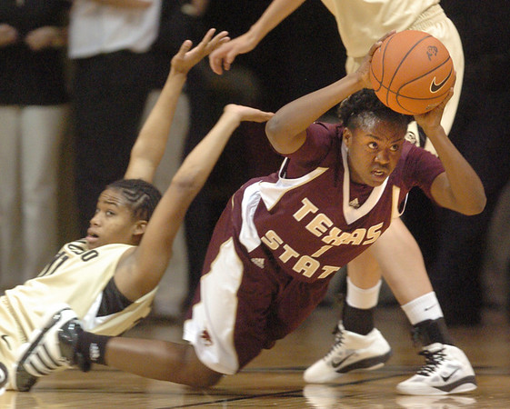 """Verinus Kalu of Texas State comes up with a loose ball from Brittany Wilson of CU.<br /> For more photos of the game, go to  <a href=""""http://www.dailycamera.com"""">http://www.dailycamera.com</a>.<br /> Cliff Grassmick / December 1, 2010"""