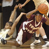 "Verinus Kalu of Texas State comes up with a loose ball from Brittany Wilson of CU.<br /> For more photos of the game, go to  <a href=""http://www.dailycamera.com"">http://www.dailycamera.com</a>.<br /> Cliff Grassmick / December 1, 2010"