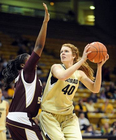 "Rachel Hargis of CU shoots over Chika Ofoegbu of Texas State.<br /> For more photos of the game, go to  <a href=""http://www.dailycamera.com"">http://www.dailycamera.com</a>.<br /> Cliff Grassmick / December 1, 2010"