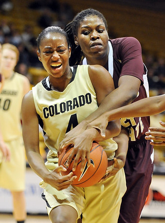 "Britney Blythe of CU is tied up by Chika Ofoegbu of Texas State.<br /> For more photos of the game, go to  <a href=""http://www.dailycamera.com"">http://www.dailycamera.com</a>.<br /> Cliff Grassmick / December 1, 2010"
