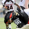 Texas Tech running back Eric Stephens breaks a tackle from University of Colorado freshman Chidera Uzo-Diribe during the football game against Texas Tech on Saturday, Oct. 23, at Folsom Field.<br /> Jeremy Papasso/ Camera