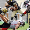 University of Colorado tailback Rodney Stewart jumps over Texas Tech lineman Colby Whitlock during the football game against Texas Tech on Saturday, Oct. 23, at Folsom Field.<br /> Jeremy Papasso/ Camera