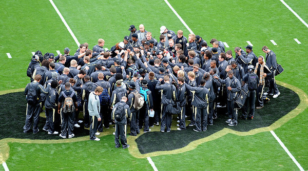 """The University of Colorado football team gathers at the buffalo at the 50-yard line before the Texas Tech game at Folsom Field.<br /> For more photos of the game, go to  <a href=""""http://www.dailycamera.com"""">http://www.dailycamera.com</a><br /> Cliff Grassmick / October 23, 2010"""