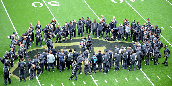 "The University of Colorado football team gathers at the buffalo at the 50-yard line before the Texas Tech game at Folsom Field.<br /> For more photos of the game, go to  <a href=""http://www.dailycamera.com"">http://www.dailycamera.com</a><br /> Cliff Grassmick / October 23, 2010"