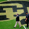 "University of Colorado  football coach, Dan Hawkins, walks past the buffalo at midfield before the Texas Tech game at Folsom Field.<br /> For more photos of the game, go to  <a href=""http://www.dailycamera.com"">http://www.dailycamera.com</a><br /> Cliff Grassmick / October 23, 2010"