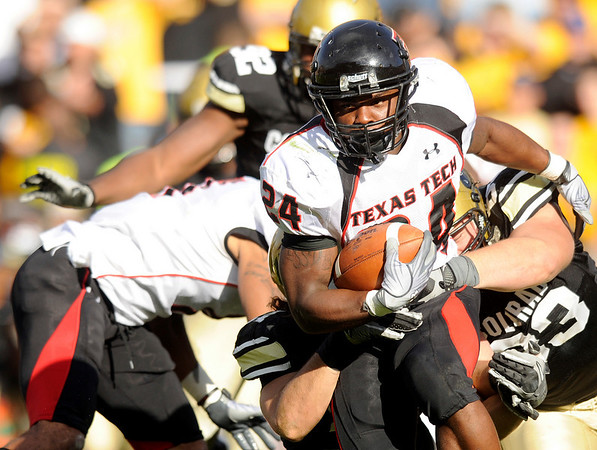 Texas Tech running back Eric Stephens rushes the ball through the University of Colorado defense during the football game against CU on Saturday, Oct. 23, at Folsom Field in Boulder, Colo.<br /> Jeremy Papasso/ Camera