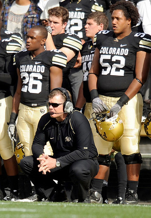 University of Colorado head coach Dan Hawkins watches as quarterback Tyler Hansen is tended to after being injured during the football game against Texas Tech on Saturday, Oct. 23, at Folsom Field.<br /> Jeremy Papasso/ Camera
